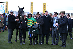 Jonjo O'Neill Jr (centre), trainer Joseph P O'Brien and John P McManus celebrates victory at the Martin Pipe Conditional Jockey's Handicap Hurdle during Gold Cup Day of the 2019 Cheltenham Festival at Cheltenham Racecourse.