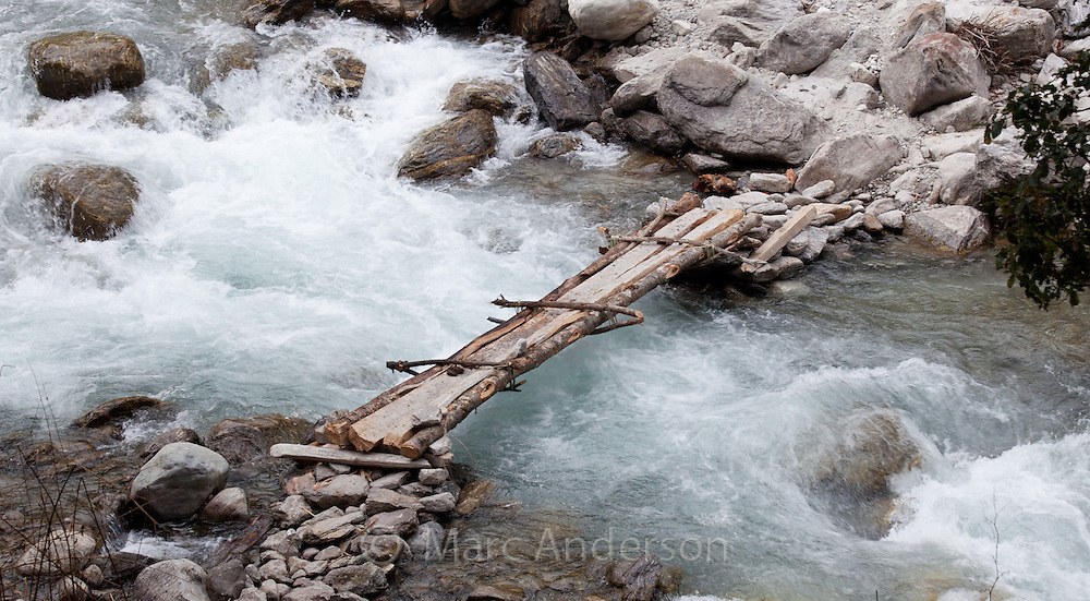 Small wooden bridge over a fast flowing river, Langtang Valley, Nepal