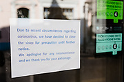 MERTHYR TYDFIL, WALES - 20 APRIL 2020 - Local chinese take away displays a closure sign in its shop window due to the covid-19, corona virus epidemic lockdown.