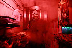 An ethnic Uighur man works in a meat stall in Urumqi city, Xinjiang Uighur Autonomous Province, China, 16 November 2017. Uighurs, a Muslim ethnic minority group in China, make up about 40 per cent of the 21.8 million people in Xinjiang, a vast, ethnically divided region that borders Pakistan, Afghanistan, Kazakhstan, Kyrgyzstan and Mongolia. Other ethnic minorities living in here include the Han Chinese, Kyrgyz, Mongolian and Tajiks people. Xinjiang has long been subjected to separatists unrests and violent terrorist attacks blamed by authorities on Islamist extremism while human rights groups say Chinese repression on religious rights, culture and freedom of movement caused undue tensions. Life however goes on under the watchful eye of the government for the ethnic Uighurs living in the city of Urumqi and surrounding areas and the region is still considered an attractive tourist spot. A recent report by state media Xinhua news agency claims Xinjiang received more than 100 million tourists in 2017, 'the highest figure in its history'.