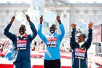 Men's Elite winner Wilson Kipsang (C) of Kenya poses with second placed Stanley Biwott (L) of Kenya and third placed Tsegaye Kebede (R) of Ethiopia following the Virgin Money London Marathon on April 13, 2014 in London, England.<br /> The Virgin Money London Marathon 2014<br /> 13 April 2014<br /> Photo: Dillon Bryden/Virgin Money London Marathon<br /> media@london-marathon.co.uk