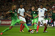 England forward Marcus Rashford battles with Slovenia's Aljaz Struna  during the FIFA World Cup Qualifier match between England and Slovenia at Wembley Stadium, London, England on 5 October 2017. Photo by Martin Cole.