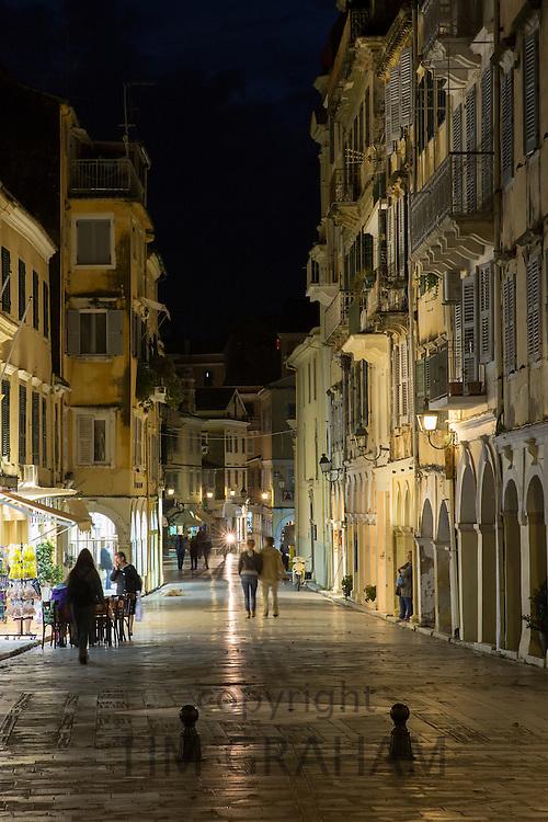 People strolling at night by the Spianada in Kerkyra, Corfu Town, Greece