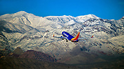 A Southwest Airlines plane takes off from McCarran International Airport over the snow-dusted mountain about the city on Tuesday, Jan. 24, 2017.   L.E. Baskow