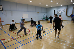 Children with disabilities playing football,