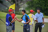 Sadom KAEWKANJANA (THA) and KK LIMBHASUT (THA) shake hands with caddies following Rd 3 of the Asia-Pacific Amateur Championship, Sentosa Golf Club, Singapore. 10/6/2018.<br /> Picture: Golffile | Ken Murray<br /> <br /> <br /> All photo usage must carry mandatory copyright credit (© Golffile | Ken Murray)