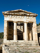 Temple of Apollo st Delphi UNESCO World Heritage Site Greece Europe the  moon can be seen in the blue sky