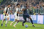 Juventus Forward Juan Cuadrado tackles Manchester United Midfielder Paul Pogba during the Champions League Group H match between Juventus FC and Manchester United at the Allianz Stadium, Turin, Italy on 7 November 2018.