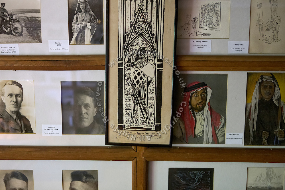 """Items that belonged to T. E. Lawrence, (""""Lawrence of Arabia"""") are on display, along with pictures and books, inside his bedroom in Clouds Hill, his former home near Wool, Dorset, southwest England."""