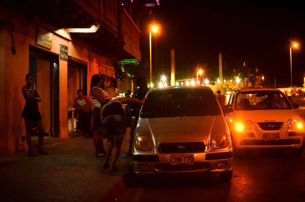 Women stand outside of a brothel soliciting men in passing cars in Cartagena, Colombia, where prostitution is legal. A sex scandal erupted recently when secret service agents were found bringing prostitutes to their hotel rooms while in Cartagena preparing for President Barack Obama's arrival to the Summit of the Americas.