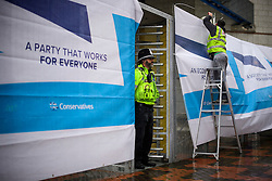 © Licensed to London News Pictures. 01/10/2016. Birmingham, UK. Conservative Party branding being attached to a security fence surrounding the conference venue. Heightened police and security presence around the ICC in Birmingham City centre ahead of the  Conservative Party Conference which starts tomorrow (Sun). Photo credit: Ben Cawthra/LNP
