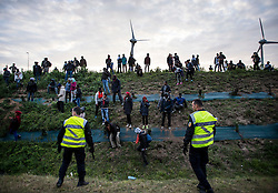 © London News Pictures. Calais, France. French police attempt to stop immigrants from reaching the Eurotunnel complex. Migrants attempting to reach the UK via the Eurotunnel at Calais in France. The situation has reached crisis point, which French police over run by attempts to cross the border. Photo credit: Ben Cawthra /LNP