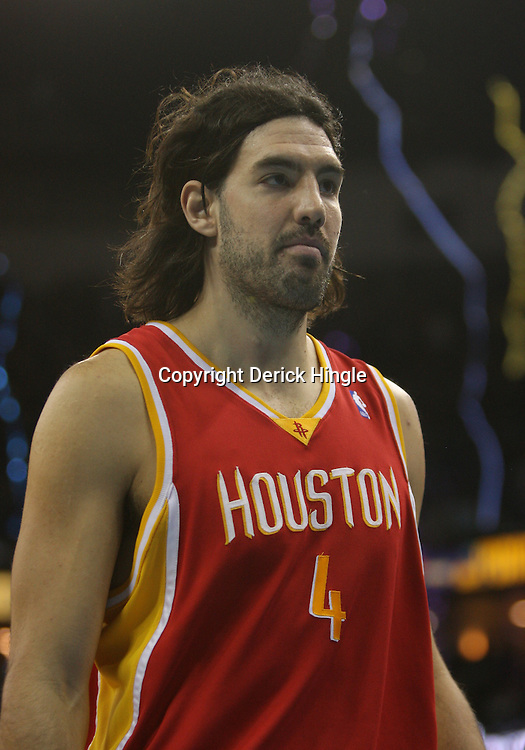 Jan 02, 2010; New Orleans, LA, USA; Houston Rockets forward Luis Scola (4) walks off the court following a loss to the New Orleans Hornets at the New Orleans Arena. The Hornets defeated the Rockets 99-95. Mandatory Credit: Derick E. Hingle-US PRESSWIRE
