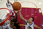 Jun 8, 2018; Cleveland, OH, USA; Golden State Warriors guard Shaun Livingston (34) and Cleveland Cavaliers forward Jeff Green (32) go for a rebound during the first quarter in game four of the 2018 NBA Finals at Quicken Loans Arena.