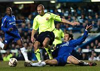 Photo: Richard Lane.<br />Chelsea v Barcelona. UEFA Champions League. 22/02/2006.<br />Barcelona's Henrik Larsson is tackled by Ricardo Carvalho.