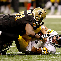Oct 31, 2010; New Orleans, LA, USA; Pittsburgh Steelers quarterback Ben Roethlisberger (7) is sacked by New Orleans Saints defensive end Will Smith (91) during a game against the New Orleans Saints at the Louisiana Superdome. The Saints defeated the Steelers 20-10.  Mandatory Credit: Derick E. Hingle