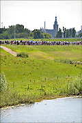 Nederland, the Netherlands, Nijmegen, 21-7-2015Op de Wedren starten om 4 uur de eerste lopers van de 4 daagse. Via de Waalbrug ging het naar de Betuwe en via de Oosterhoutsedijk in een langgerekt lint weer terug.The International Four Day Marches Nijmegen, or Vierdaagse, is the largest marching event in the world. It is organised every year in Nijmegen in mid-July as a means of promoting sport and exercise. Participants walk 30, 40 or 50 kilometers daily, and, on completion, receive a royally approved medal, Vierdaagsekruis. The participants are mostly civilians, but there are also a few thousand military participants. The vierdaagse, Dutch for Four day Event, is an annual walk that has taken place since 1909, being based at Nijmegen since 1916.Foto: Flip Franssen/Hollandse Hoogte