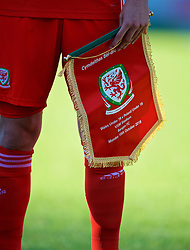 BANGOR, WALES - Monday, October 15, 2018: Wales' captain Ryan Reynolds hold the match-day pennant before the UEFA Under-19 International Friendly match between Wales and Poland at the VSM Bangor Stadium. (Pic by Paul Greenwood/Propaganda)