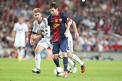 Lionel Messi attacks for Barcelona as Sergio Ramos of Real Madrid chases him.  Barcelona v Real Madrid, Supercopa first leg, Camp Nou, Barcelona, 23rd August 2012...Credit - Eoin Mundow/Cleva Media.