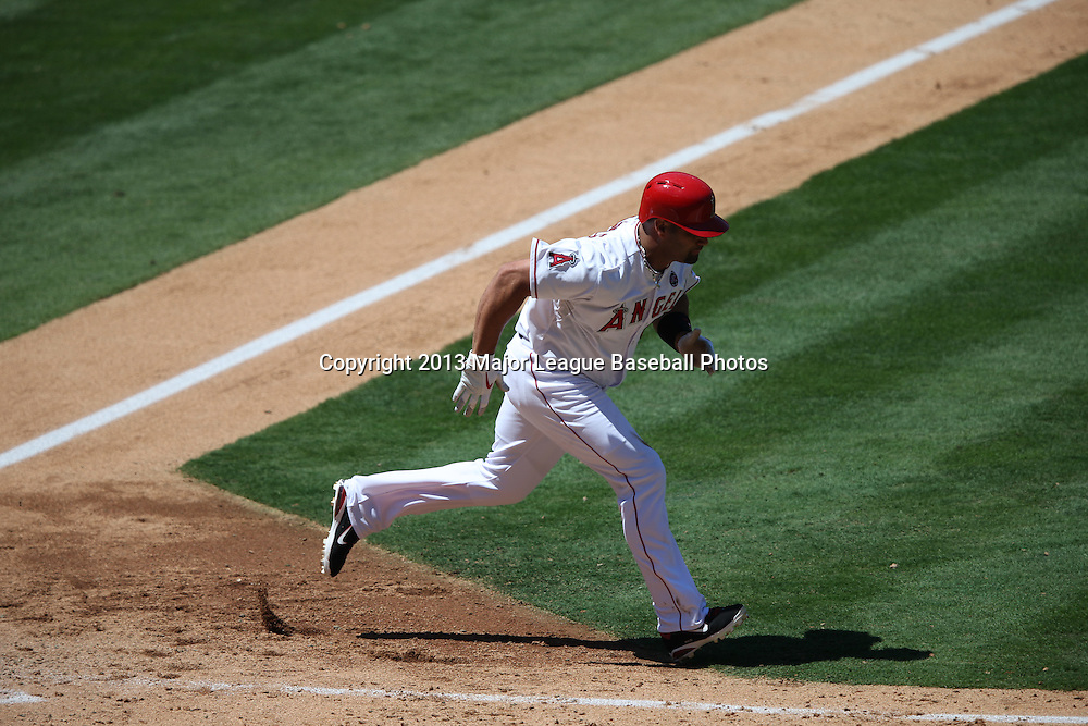 ANAHEIM, CA - JULY 24:  Albert Pujols #5 of the Los Angeles Angels of Anaheim runs to first base during the game against the Minnesota Twins on Wednesday, July 24, 2013 at Angel Stadium in Anaheim, California. The Angels won the game in a 1-0 shutout. (Photo by Paul Spinelli/MLB Photos via Getty Images) *** Local Caption *** Albert Pujols