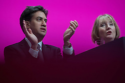 © Licensed to London News Pictures . 21/09/2014 . Manchester , UK . Ed Miliband and Harriet Harman sit and listen to Iain McNicol speaking on the stage at the start of the first day of the 2014 Labour Party Conference . Photo credit : Joel Goodman/LNP