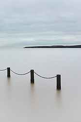 A quick trip down to Weston Supermare saw me intending to shoot the classic image of the tide just covering the causeway at the marine lake. However the muted sky and muddy waters attracted me to something entirely more minimalist.<br />