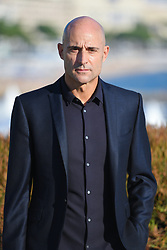 Mark Strong pose at the photocall of 'Deep State' during MIPCOM (International Market of Communications Programmes) at Palais des Festivals et des Congres, Cannes<br />