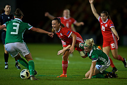 NEWPORT, WALES - Tuesday, September 3, 2019: Wales' Natasha Harding is tackled by Northern Ireland's Julie Nelson during the UEFA Women Euro 2021 Qualifying Group C match between Wales and Northern Ireland at Rodney Parade. (Pic by David Rawcliffe/Propaganda)