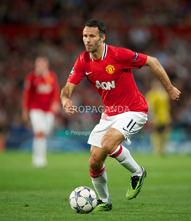 MANCHESTER, ENGLAND - Tuesday, September 27, 2011: Manchester United's Ryan Giggs in action against FC Basel 1893 during the UEFA Champions League Group C match at Old Trafford. (Pic by David Rawcliffe/Propaganda)