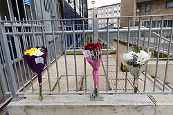 © Licensed to London News Pictures. 13/04/2018. London, UK. Flowers and messages outside Galleon House, Manchester Road on the Isle of Dogs in Tower Hamlets. A man in his 30's was found injured from a stab wound yesterday morning and died at the scene. A woman, Alex Glanfield-Collis, of Manchester Road has been charged with murder, to appear at Thames Magistrates Court this morning. Photo credit: Vickie Flores/LNP