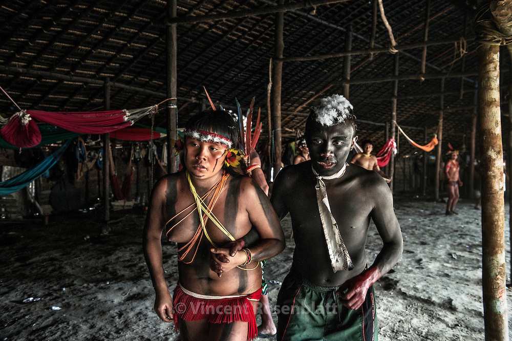 Welcoming party. With feathers of Arara (perrots) girls and boys dance to present themselves to the village and guests. Maybe the premices of a future union..
