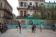 Young men playing an evening game of volleyball being played in a square on calle Lamparilla in Old Havana, Havana, Cuba