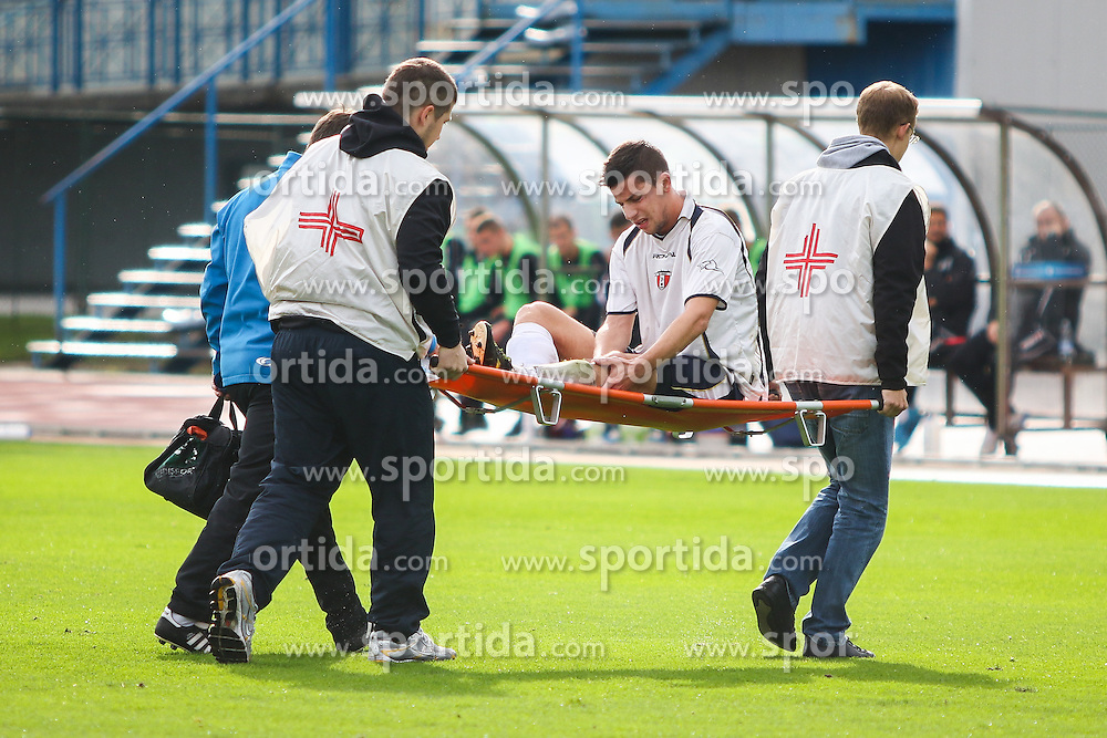 Ziga Jurhar injured during football match between NK Triglav Kranj and NK Kranj  in 10th Round of 2. SNL, on October 11, 2015 in Sports center Kranj,Kranj, Slovenia. Photo by Ziga Zupan / Sportida