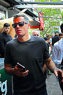 Former Liverpool player Jamie Carragher makes his was through a crowded bar area in a city square in Basel pictured ahead of the UEFA Europa League Final at St. Jakob-Park, Basel<br /> Picture by Kristian Kane/Focus Images Ltd 07814482222<br /> 18/05/2016