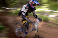 JEROME A. POLLOS/Press..Race participants speeding through technical terrain on the downhill course are often a crowd favorite since spectators can get close to the action.