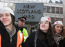© under license to London News Pictures. 14/12/10. Protesters hold a demonstration outside New Scotland yard, in London, over the Metropolitan Police's 'kettling' tactics at recent demonstrations . Credit should read Matt Cetti-Roberts/London News Pictures