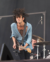 © Licensed to London News Pictures. 14/06/2014. Isle of Wight, UK.   The 1975 performing live at Isle of Wight Festival .  In this picture Matthew Healy.  The 1975 are an English indie rock band formed consisting of Matthew Healy (vocals, guitar), Adam Hann (guitar), George Daniel (drums) and Ross MacDonald (bass)  The Isle of Wight festival is an annual music festival that takes place on the Isle of Wight. Photo credit : Richard Isaac/LNP