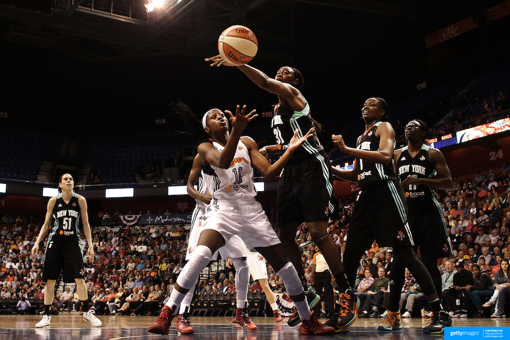 Chiney Ogwumike, (left), Connecticut Sun, and Tina Charles, New York Liberty, challenge for a rebound during the Connecticut Sun Vs New York Liberty WNBA regular season game at Mohegan Sun Arena, Uncasville, Connecticut, USA. 16th May 2014. Photo Tim Clayton