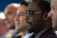 SAN FRANCISCO, CA - DEC 7:   Black Eyed Peas front man will.i.am listens to Marc Benioff, Chairman & CEO of Salesforce.com deliver a keynote speech during the 2010 DreamForce Global Gathering being held at the Moscone Center on December 7, 2010 in San Francisco, California.  Photography by David Paul Morris
