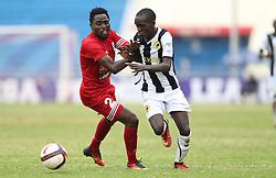 Simon Mbugua of Posta Rangers shields against Boniface Muchiri of Tusker Rangers during their Sportpesa Prmier League tie match at the Nyayo Stadium Nairobi on the 2 August 2017. Photo/ Fredrick Omondi/www.Piccentre.com (KEN)