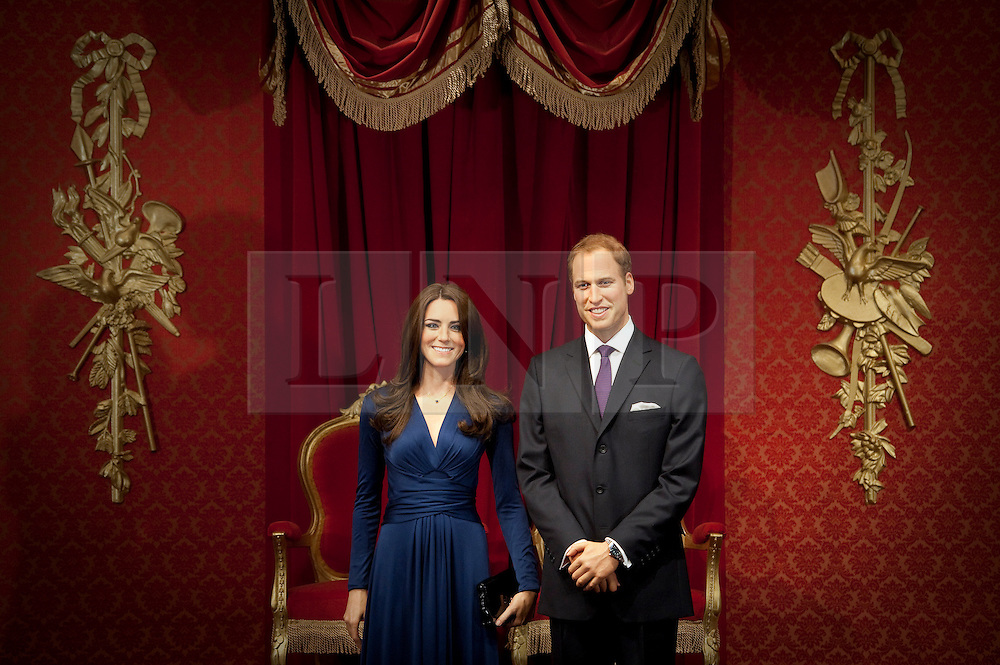 © London News Pictures. 04/04/2012. London, UK.  Wax work figures of The Duke and Duchess of Cambridge, CATHERINE (KATE) MIDDLETON and PRINCE WILLIAM at their unveiling at Madame Tussauds in London on April 4, 2012. The couple are portrayed in their engagement pose. Photo credit :  Ben Cawthra/LNP