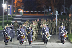 © Licensed to London News Pictures . 25/04/2013. Catterick Barracks , North Yorkshire , UK . The returning soldiers parade towards their waiting families and friends , lead by a marching band . Soldiers from the 1st Battalion , the Duke of Lancaster's Regiment (1 Lancs) arrive at Catterick Barracks to be greeted by their families this evening (Thursday 25th April), following a six month tour in Lashkar Gah , Helmand Province , Afghanistan . With the UK combat mission due to complete by the end of 2014 , this is likely to be the last deployment by 1 Lancs in Afghanistan , the British Army reports . Photo credit : Joel Goodman/LNP