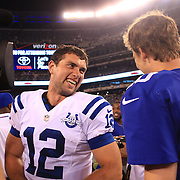 Indianapolis Colts quarterback Andrew Luck (left) with New York Giants quarterback Eli Manning after the New York Giants V Indianapolis Colts, NFL American Football Pre Season match at MetLife Stadium, East Rutherford, NJ, USA. 18th December 2013. Photo Tim Clayton