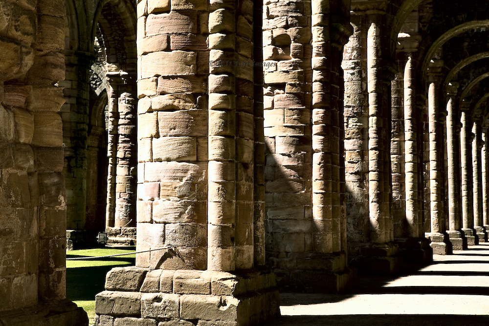 Yorkshire, Fountains Abbey ruins.  View of colonnade separating the nave and side aisle on the north side.