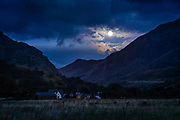 We'd been so engrossed in our rock-climbing that we hadn't even noticed the full-moon behind us, rising above Crib Goch ridge on Yr Wyddfa (Snowdon) <br /> <br /> Had to stop to grab a snap from the roadside, so thankful that I'd left my tripod in the van.