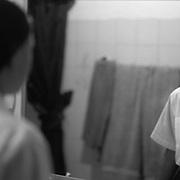 ANGELA JIMENEZ-CR roll 18 February 15, 1999<br />Kattia looks in the mirror before school.