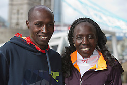 © Licensed to London News Pictures. 18/04/2013. London, England. Pictured: Kenyan runner Edna Kiplagat with husband/coach Gilbert Koech. Virgin London Marathon - Photocall with International Women Runners Athletes Tiki Gelana (ETH), Edna Kiplagat (KEN), Priscah Jeptoo (KEN) and Yoko Shibui (JPN) at Tower Bridge ahead of Sunday's run, London. Photo credit: Bettina Strenske/LNP