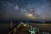 Summer awakens at the jersey shore on long Beach Island. I captured the Milky Way arching over the Barnegat Inlet.