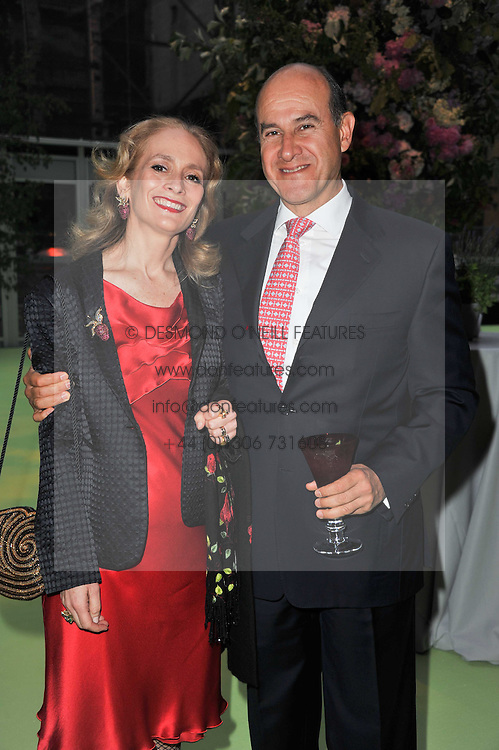 MR & MRS JOSE RAMON LOPEZ-PORTILLO at a dinner hosted by Cartier in celebration of the Chelsea Flower Show held at Battersea Power Station, 188 Kirtling Street, London SW8 on 23rd May 2011.