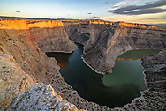 I waited on this precarious ledge for the sun to come out one more time over Bighorn Canyon before setting. The light only lasted a couple minutes. I'm not sure what caused the 2 different colors mixing together in the river.